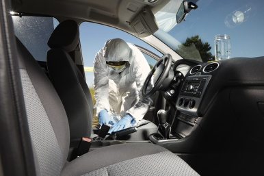 Criminologists technician collecting odor evidences of crime